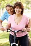 Senior Hispanic couple with bike Stock Images