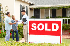 Senior Hispanic couple buying new home. Happy senior Hispanic couple buying new home Stock Photo