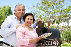Senior Hispanic Couple Checking Mailbox stock photos