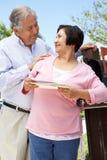 Senior Hispanic Couple Checking Mailbox Stock Image