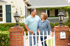 Senior Hispanic couple outside home Royalty Free Stock Image