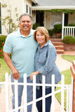 Senior Hispanic couple outside home Stock Photos