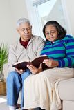 Senior Hispanic Couple Reading Bible Royalty Free Stock Images