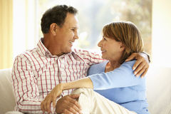 Senior Hispanic Couple Relaxing At Home Royalty Free Stock Images