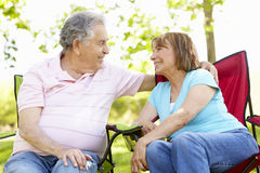 Senior Hispanic Couple Relaxing In Park Royalty Free Stock Photos