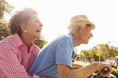 Senior Hispanic Couple Riding Bikes In Park Royalty Free Stock Images