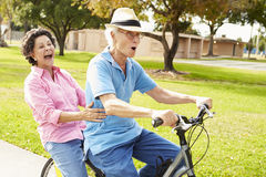 Senior Hispanic Couple Riding Bikes In Park Royalty Free Stock Photography