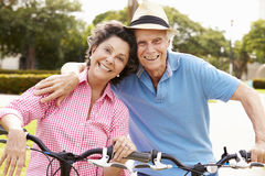 Senior Hispanic Couple Riding Bikes In Park Royalty Free Stock Photos