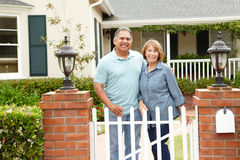 Senior Hispanic couple standing outside home Royalty Free Stock Images