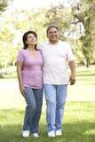 Senior Hispanic Couple Walking In Park Royalty Free Stock Photography