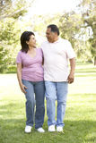 Senior Hispanic Couple Walking In Park Royalty Free Stock Images