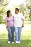 Senior Hispanic Couple Walking In Park Royalty Free Stock Images