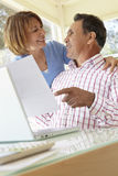 Senior Hispanic Couple Working In Home Office Stock Image