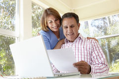 Senior Hispanic Couple Working In Home Office Royalty Free Stock Photos