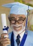 Senior Hispanic Male Graduate Stock Images