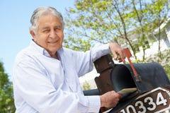 Senior Hispanic Man Checking Mailbox Royalty Free Stock Image