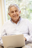 Senior Hispanic man with laptop royalty free stock photos