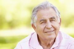 Senior Hispanic Man Relaxing In Park Stock Photos