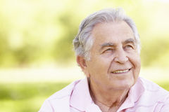 Senior Hispanic Man Relaxing In Park Royalty Free Stock Photos