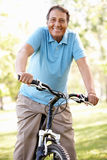 Senior Hispanic man riding bike Royalty Free Stock Photography