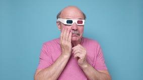 Senior hispanic man in special glasses watching melodrama crying.