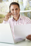 Senior Hispanic Man Working In Home Office Royalty Free Stock Photo