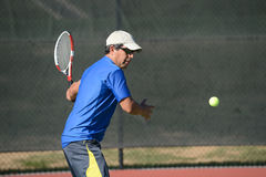 Senior Hispanic Playing Tennis Stock Image