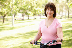Senior Hispanic woman with bike Stock Images