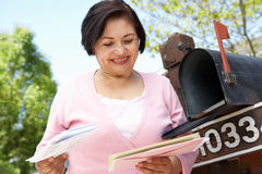 Senior Hispanic Woman Checking Mailbox Royalty Free Stock Images