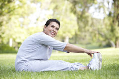 Senior Hispanic Woman Exercising In Park Stock Photos