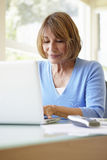 Senior Hispanic Woman Using Laptop In Home Office Royalty Free Stock Photography