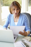 Senior Hispanic Woman Working In Home Office Stock Photos