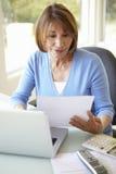 Senior Hispanic Woman Working In Home Office Stock Photos