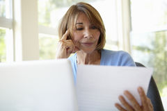 Senior Hispanic Woman Working In Home Office Stock Image