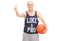 Senior holding basketball and giving a thumb up Royalty Free Stock Photos