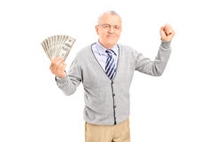 Senior holding cash and gesturing happiness Royalty Free Stock Images