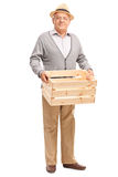 Senior holding an empty wooden crate Stock Photography