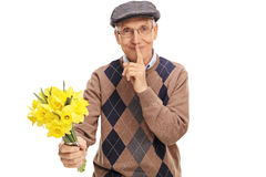 Senior holding flowers and finger on lips Royalty Free Stock Photography