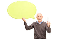 Senior holding a light bulb and a speech bubble Royalty Free Stock Photo