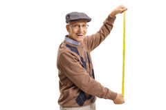 Senior holding a measuring tape stock photography