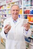 Senior holding medicine box and prescription Stock Photo
