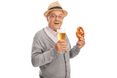 Senior holding a pretzel and a beer Royalty Free Stock Images