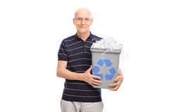 Senior holding a recycle bin full of shredded paper Royalty Free Stock Photography