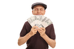 Senior holding and smelling money Royalty Free Stock Photography