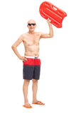 Senior holding a swimming float up in the air Royalty Free Stock Image