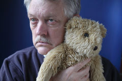Senior holding teddy bear Stock Photography