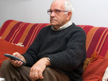 Senior holding TV remote Royalty Free Stock Images