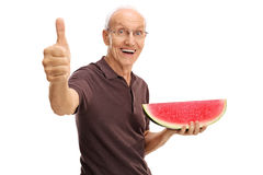 Senior holding a watermelon slice Royalty Free Stock Image