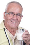 Senior holdsa glass of milk in hand Royalty Free Stock Photo