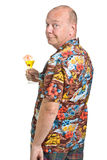 Senior on Holiday. Expressive old man in loud shirt holiday concept isolated against white Royalty Free Stock Image